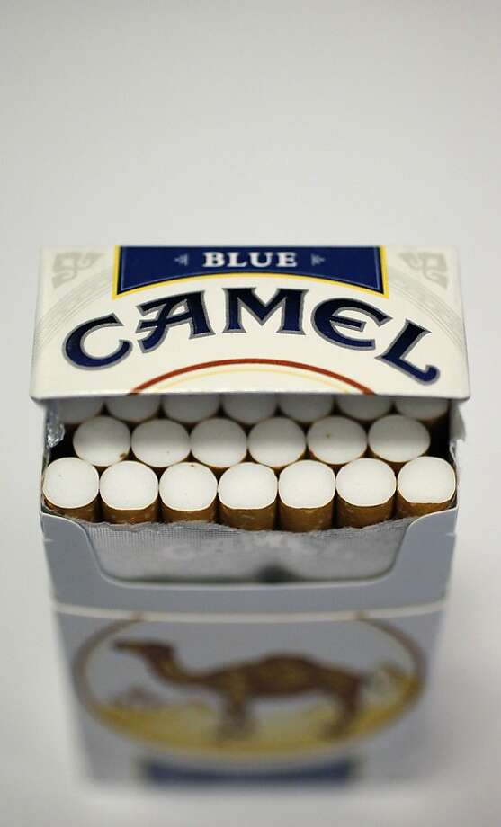 Pictured is an open pack of Camel cigarettes purchased Friday, Nov. 30, 2012, in Chicago. New tobacco products have come nearly to a halt in the U.S. because regulatory reviews for thousands of applications required by a 2009 law are taking much longer than the law requires. Though it might sound like good news from a health perspective, the halt demonstrates how tricky it is to start regulating an industry.(AP Photo/Charles Rex Arbogast) Photo: Charles Rex Arbogast, Associated Press