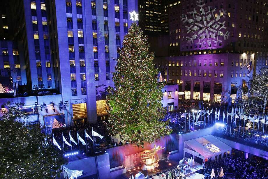 In this Wednesday, Nov. 28, 2012 photo, the Rockefeller Center Christmas tree is lit during the 80th annual tree lighting ceremony at Rockefeller Center in New York. Scientists are working to decipher the DNA code of conifers, like this Norway spruce at Rockefeller Center in New York. In late 2012, scientific teams in the United States and Canada have released preliminary, patchy descriptions of conifer genomes. And a Swedish team plans to follow suit soon in its quest for the Norway spruce. (AP Photo/Kathy Willens) Photo: Kathy Willens, Associated Press