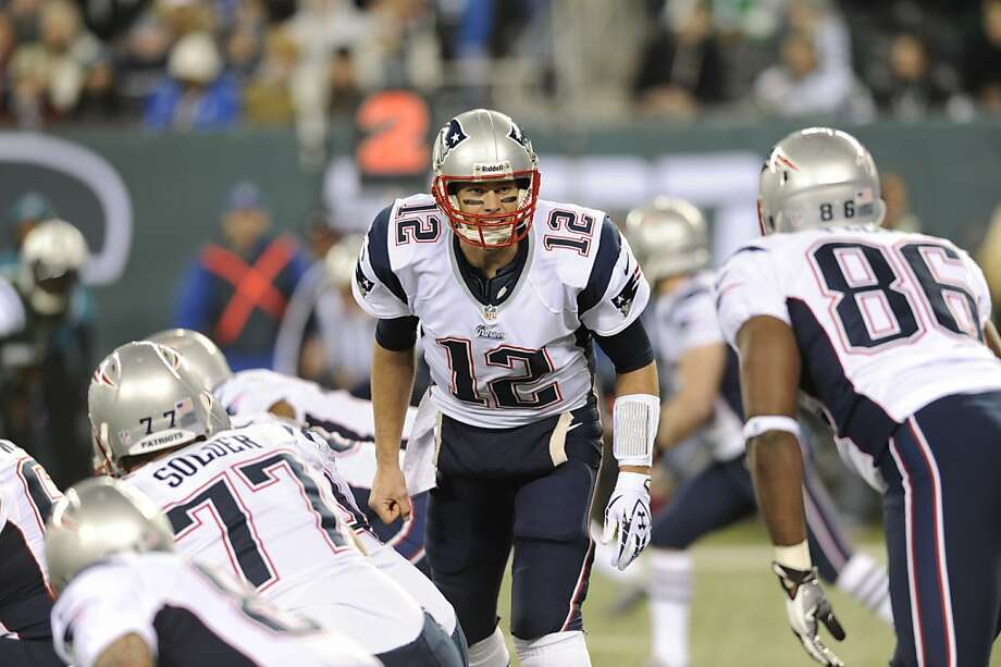 A primary purpose of the no-huddle offense is to allow quarterback Tom Brady, a 13-year veteran, extra time to survey an on-its-heels defense and adjust accordingly. Photo: Bill Kostroun, Associated Press