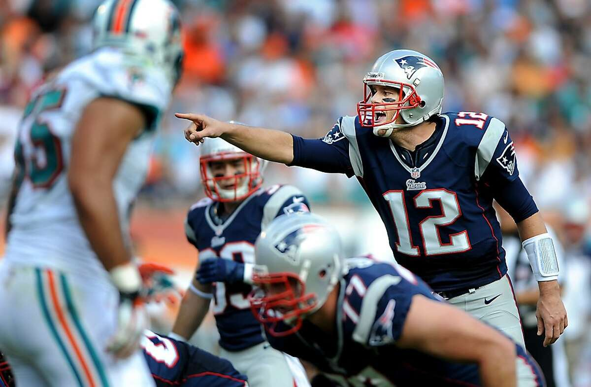 New England Patriots quarterback Tom Brady calls out an audible in the second quarter of an NFL game against the Miami Dolphins at Sun Life Stadium on Sunday, December 2, 2012, in Miami Gardens, Florida. The New England Patriots defeated the Miami Dolphins, 23-16. (Robert Duyos/Sun Sentinel/MCT)