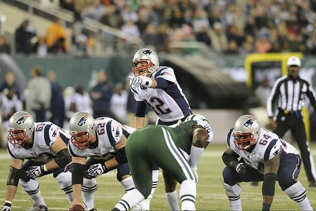 New England Patriots quarterback Tom Brady (12) calls out the defense during the first half of an NFL football game against the New York Jets Thursday, Nov. 22, 2012 in East Rutherford, N.J. (AP Photo/Bill Kostroun) Photo: Bill Kostroun, Associated Press