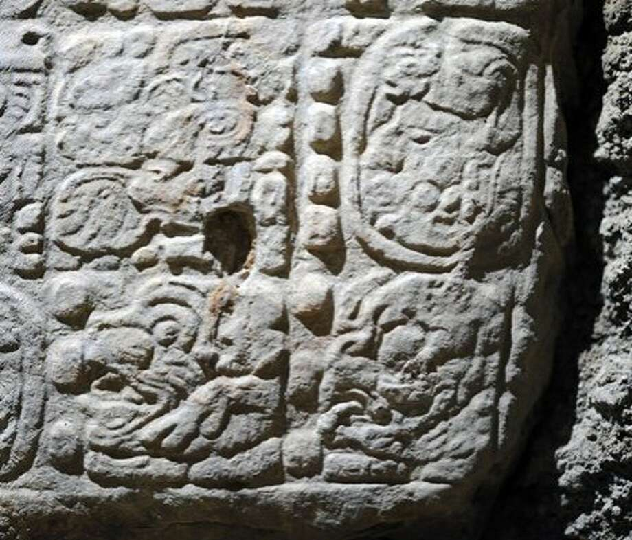 "This glyph, a 1,300-year-old Guatemalan stone inscription, says ""and it will be the 13th B'ak'tun.""   The glyph refers to the so-called ""end date"" of the Maya calendar, Dec. 21, 2012, but ""the entire text talks about ancient political history rather than prophecy,"" says Marcello A. Canuto, director of Tulane's Middle American Research Institute and co-director of the excavations at La Corona. Added Canuto, ""So, rather than prophesy, the 2012 reference places this king's troubled reign and accomplishments into a larger cosmological framework."" Photo: Courtesy David Stuart"