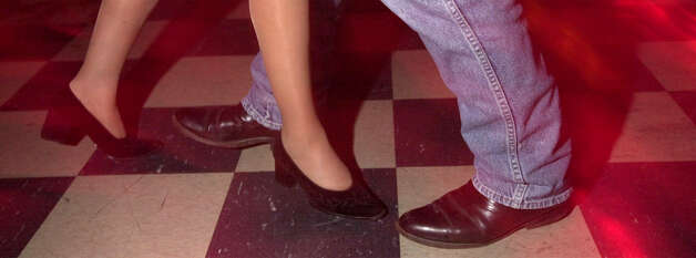A couple glides across the checkered dance floor at Lerma's Nite Club leaves the club. PHOTO BY EDWARD A. ORNELAS/STAFF Photo: EDWARD A. ORNELAS, EN / EN