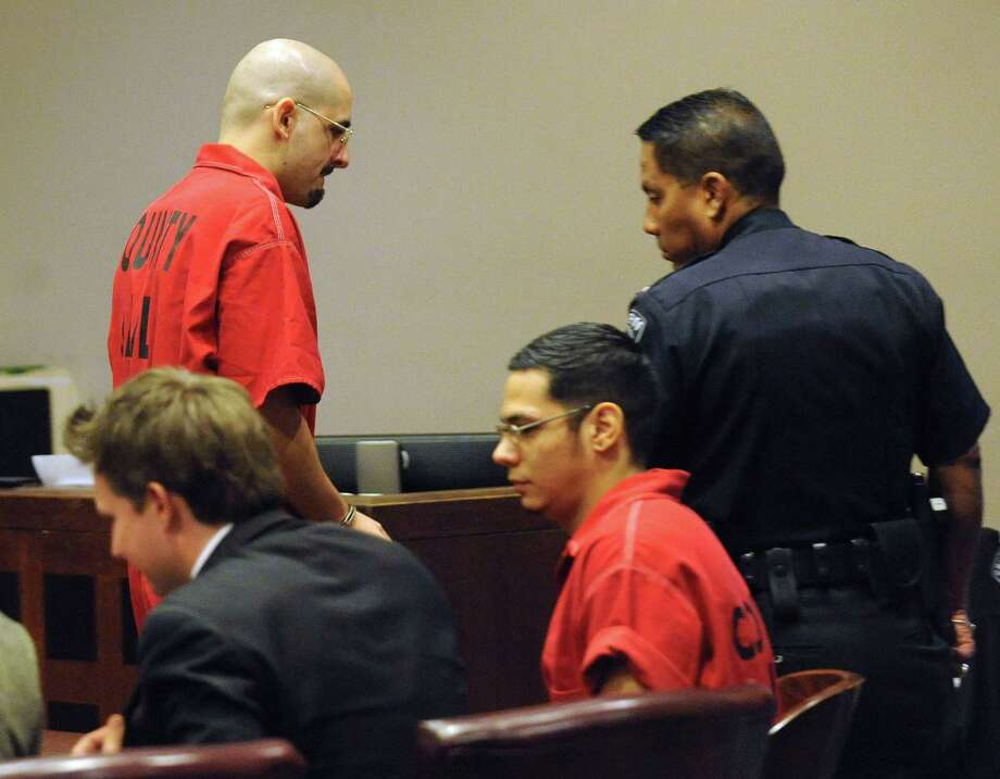 Death row inmate Juan Castillo leaves the courtroom of Judge Bert Richardson after speaking during a hearing for fellow death row inmate Noah Espada, second from right, and his request for a new trial on Wednesday, Dec. 12, 2012. Photo: Billy Calzada, San Antonio Express-News / © 2012 San Antonio Express-News