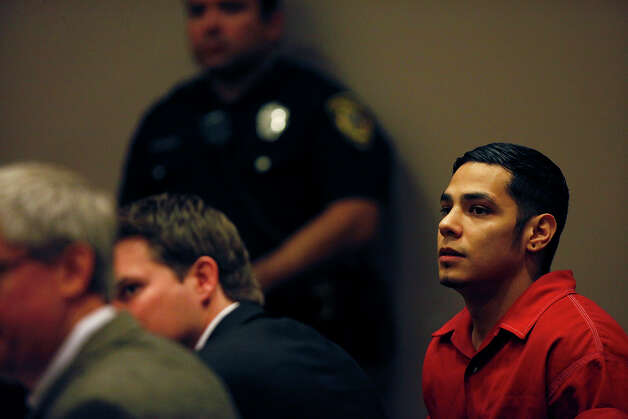 Death Row inmate Noah Espada watches the proceedings of his hearing for a new trial in the 399th District Court for his hearing at the Cadena-Reeves Justice Center in San Antonio on Wednesday, Dec. 12, 2012. Photo: Lisa Krantz, San Antonio Express-News / © 2012 San Antonio Express-News