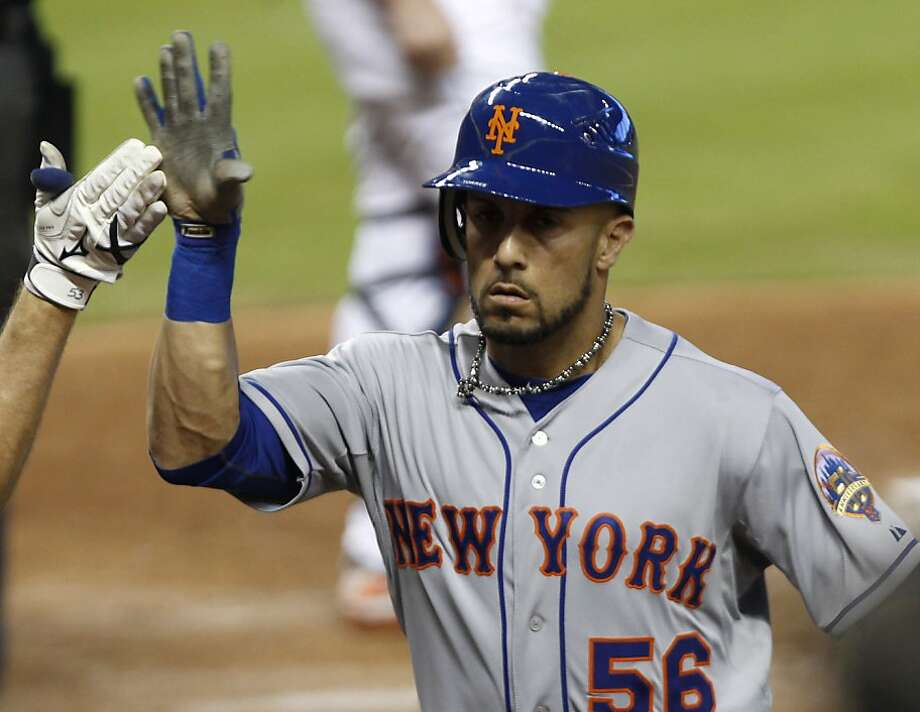 FILE - This Oct. 3, 2012 file photo shows New York Mets' Andres Torres getting a high five after batting a solo home run against the Miami Marlins in the third inning of a baseball game in Miami. Torres is returning to the San Francisco Giants, reaching agreement Thursday, Dec. 13, 2012,  on a one-year contract. The 34-year-old Torres spent the 2012 season with the New York Mets following three years with the Giants.  (AP Photo/Alan Diaz, File) Photo: Alan Diaz, Associated Press