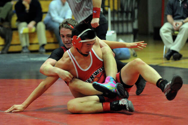 Fairfield Warde's Thomas Anania, wrestles Greenwich's Max Kim, in friont, during boys wrestling action in Fairfield, Conn. on Wednesday January 11, 2012. Photo: Christian Abraham / Connecticut Post