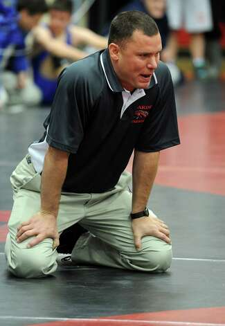 Fairfield Warde wrestling coach Jason Shaughnessy watches a match during the Fairfield Warde Invitational wrestling meet at Fairfield Warde High School Saturday, Jan. 7, 2011. Photo: Autumn Driscoll / Connecticut Post