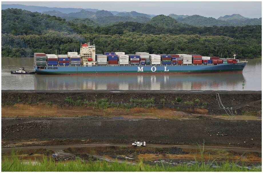 A tugboat escorts a container ship near Cocoli, Panama. The Panama Canal expansion, a $5.2 billion project, began in 2007. Photo: CARL JUSTE, MBR / Miami Herald