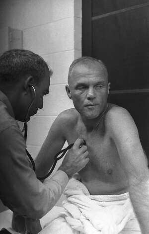 In 1962 astronaut John Glenn gets a physical checkup at Cape Canaveral before he suited up for a three-orbit flight around the Earth. Photo: ASSOCIATED PRESS