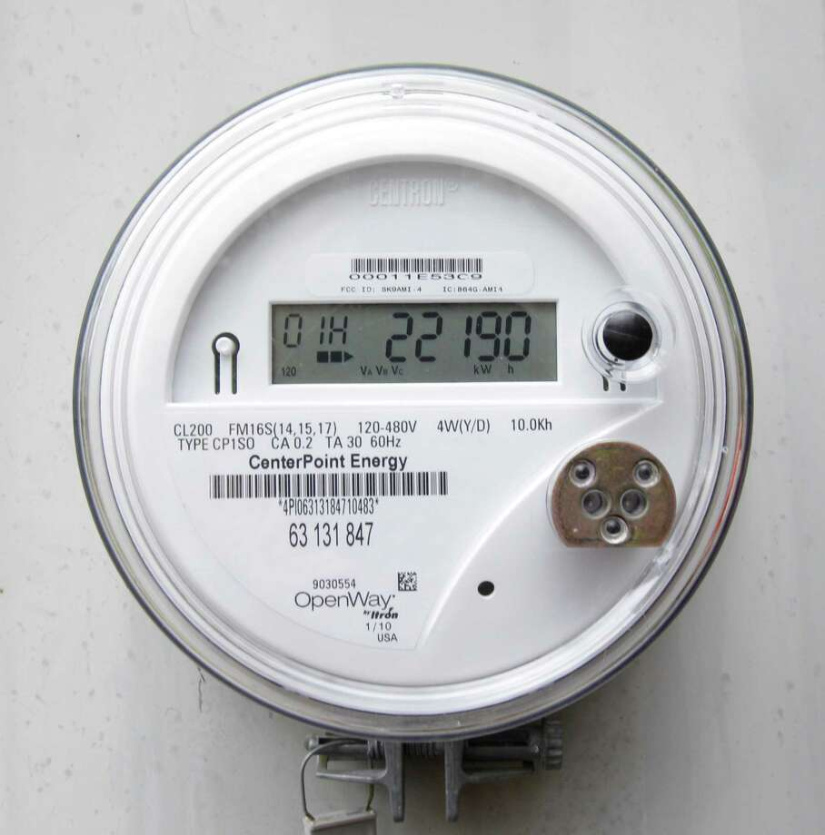 A CenterPoint Energy smart meter at the Memorial area home of Joy Demark shown Tuesday, March 13, 2012, in Houston. The meters provide real-time power use information to electricity distributors and customers. ( Melissa Phillip / Houston Chronicle ) Photo: Melissa Phillip, Staff / © 2012 Houston Chronicle