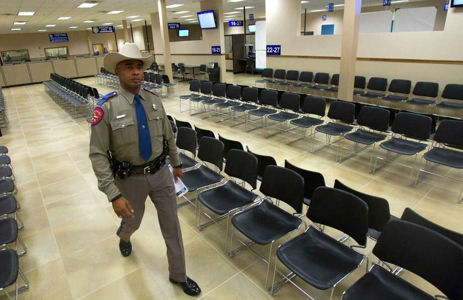 Trooper Erik Burse walks through the Spring Driver License Mega Center grand opening Thursday, Dec. 13, 2012, in Spring. The center will be staffed by 36 full-time employees and can process 700 or more customer transactions daily. Photo: Cody Duty, Houston Chronicle / © 2012 Houston Chronicle