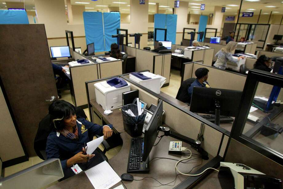 Employees prepare for the opening of the Spring Driver License Mega Center, Thursday, Dec. 13, 2012, in Spring. The center will be staffed by 36 full-time employees and can process 700 or more customer transactions daily. Photo: Cody Duty, Houston Chronicle / © 2012 Houston Chronicle