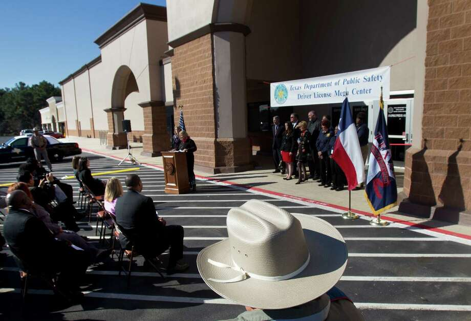 A Texas State Trooper looks on during a press conference announcing the Spring Driver License Mega Center grand opening Thursday, Dec. 13, 2012, in Spring. Photo: Cody Duty, Houston Chronicle / © 2012 Houston Chronicle