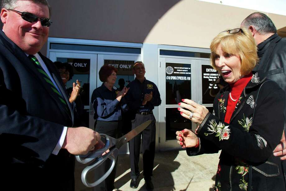State Senator Tommy Williams, left, and State Representative Debbie Riddle, right, react during the ribbon cutting ceremony at the Spring Driver License Mega Center grand opening Thursday, Dec. 13, 2012, in Spring. Photo: Cody Duty, Houston Chronicle / © 2012 Houston Chronicle