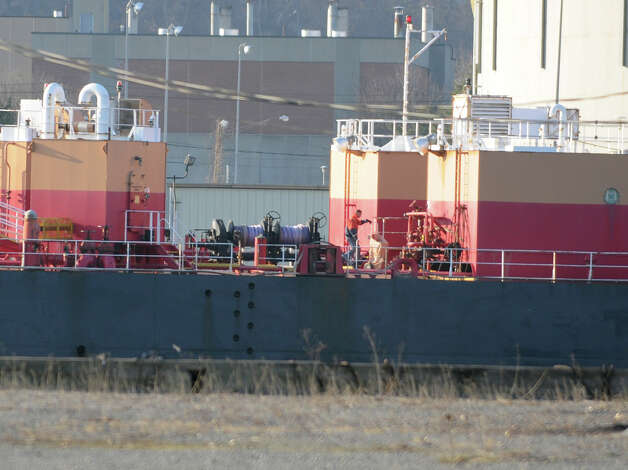 A crew member walks on the deck of a ship as it leaves the Port of Albany Thursday Dec. 13, 2012 in Albany, N.Y. Photo taken from the Rensselaer side of the Hudson River. (Lori Van Buren / Times Union) Photo: Lori Van Buren