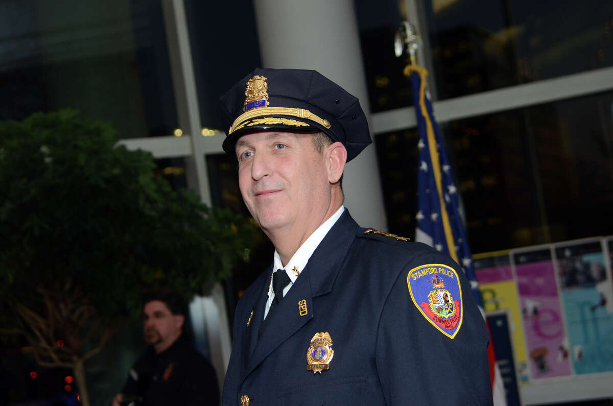 Stamford Police Chief Jon Fontneau proudly wears his Chief hat after being sworn in at the Stamford Government Center on Thursday, Dec. 13, 2012.