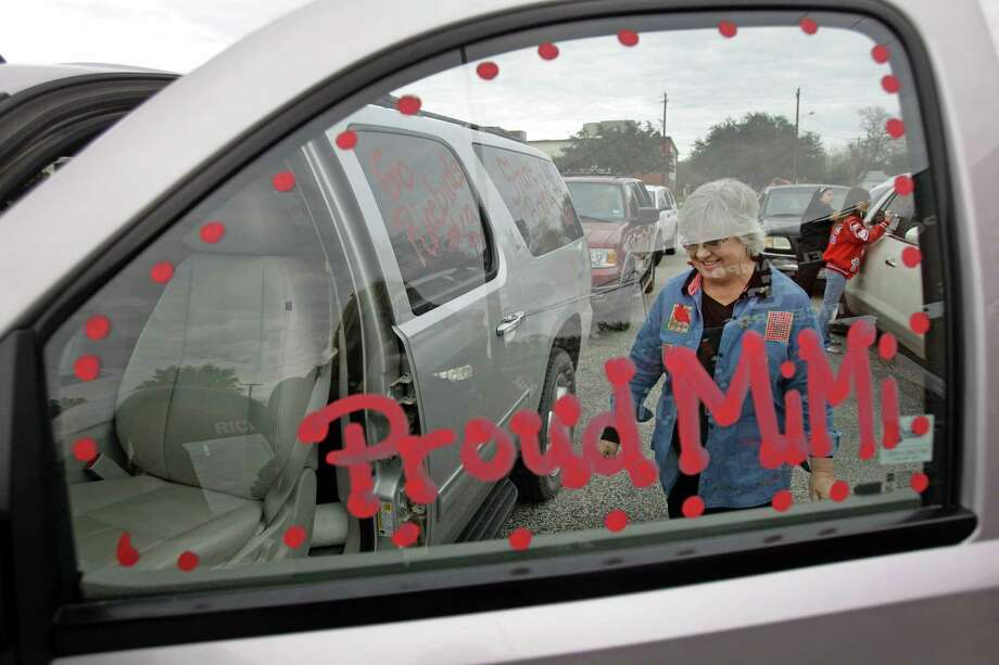 Peggy Glaze enters her vehicle after having the windows decorated at El Campo High School by members of the Derby Dolls drill team in support of the football team's state title bid Thursday, Dec. 13, 2012. Her grandson, Clay Glaze, is on football team and her husband, Ross Glaze, was on the 1967 team that was El Campo's last football to to go to state. Photo: Melissa Phillip, Houston Chronicle / © 2012 Houston Chronicle