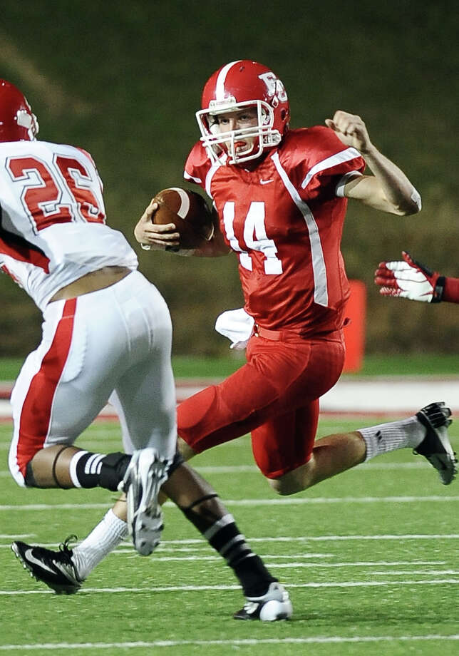 El Campo quarterback Bryce Brandl, #14, with a quarterback keeper during the El Campo High School (13-0) Class 3A Division I state semifinal game against Carthage High School (11-2) at the Lamar University Provost Umphrey Stadium in Beaumont on December, 7, 2012.