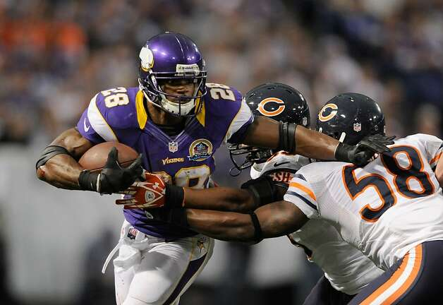 MINNEAPOLIS, MN - DECEMBER 9: Adrian Peterson #28 of the Minnesota Vikings carries the ball against Nick Roach #53 and Dom DeCicco #58 of the Chicago Bears during the fourth quarter of the game on December 9, 2012 at Mall of America Field at the Hubert H. Humphrey Metrodome in Minneapolis, Minnesota. The Vikings defeated the Bears 21-14. (Photo by Hannah Foslien/Getty Images) Photo: Hannah Foslien, Getty Images