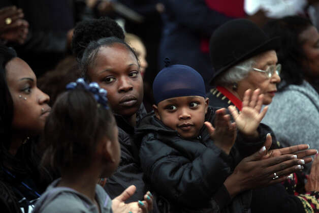 Wheatley Courts residents Destiny King, center, with her son, Dereon King, 4, and Tynika McDay, left, with her daughter, Ayanah Fields, 5, applaud during an event where the $29.7 million grant from the U.S. Department of Housing and Urban Development was announced at the apartment complex in San Antonio on Thursday, 13, 2012. Photo: Lisa Krantz, San Antonio Express-News / © 2012 San Antonio Express-News