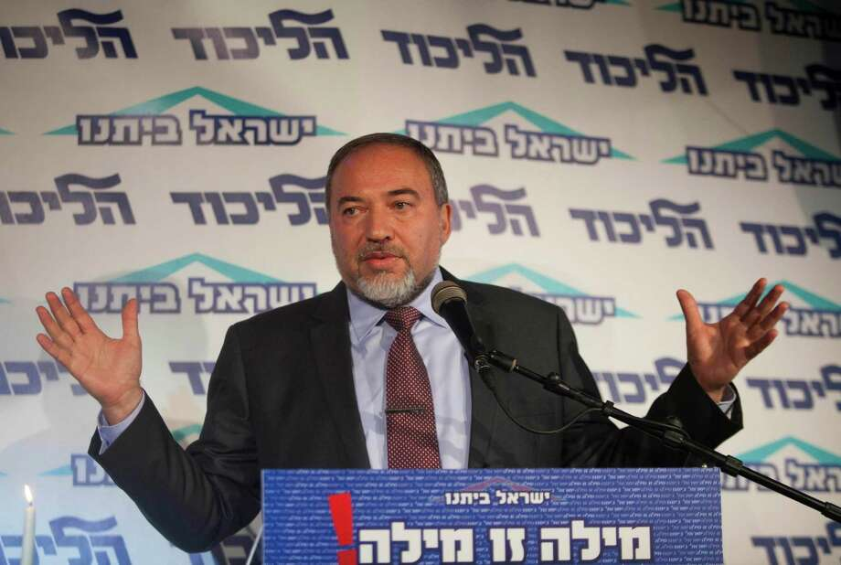 Israel's Foreign Minister Avigdor Lieberman speaks to the media during an event in Tel Aviv, Israel, Thursday, Dec. 13, 2012.  Israel's powerful foreign minister resisted calls to resign after he was charged Thursday with breach of trust for actions that allegedly compromised a criminal investigation into his business dealings, throwing the country's election campaign into disarray just weeks before the vote. (AP Photo/Dan Balilty) Photo: Dan Balilty
