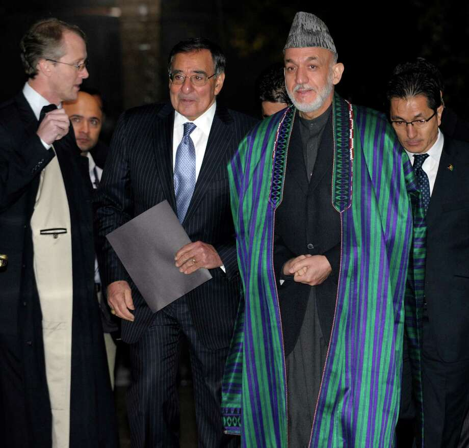 U.S. Defense Secretary Leon Panetta and Afghanistan President Hamid Karzai arrive for their joint news conference at the Presidential Palace in Kabul, Afghanistan, Thursday, Dec. 13, 2012. (AP Photo/Susan Walsh, Pool) Photo: Susan Walsh