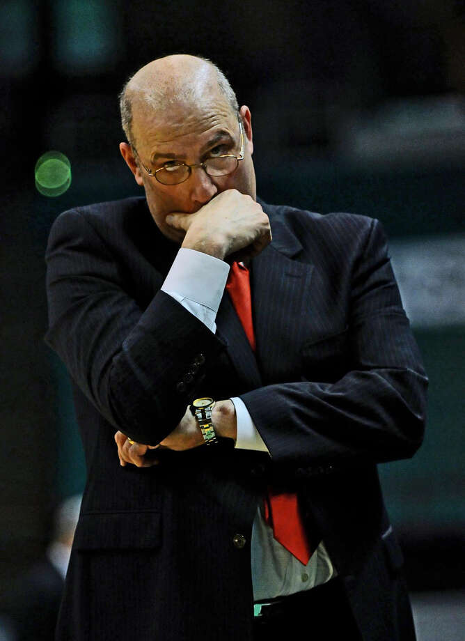 UNHAPPY COACH  PORTRAITS/PERSONALITIES Siena head basketball coach Mitch Buonaguro tries to mask his displeasure as he walks along the bench near the end of  Siena's 76-69 loss to Loyola at the Times Union Center in Albany, NY on Monday February 7, 2011.     ( Philip Kamrass / Times Union ) Photo: Philip Kamrass
