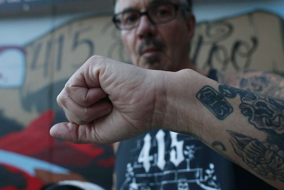 Rudy Villasenor, owner of 415 Clothing Inc. shows off 415 tattoo on his arm on Thursday Dec. 13, 2012 in San Francisco, Calif. San Francisco is discussing the possibility of changing the 415 area code to accommodate more phone users in the area.