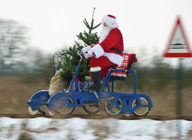 A Santa Claus rides with Christmas presents on December 12, 2012 in Mellensee, eastern Germany. Photo: PATRICK PLEUL, AFP/Getty Images / DPA
