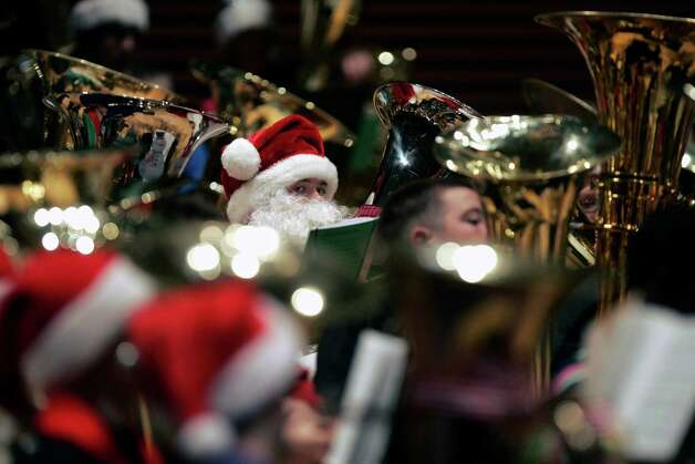 Sutton Porth, center, of Lawson Mo., High School, dressed appropriately as Santa, participates in TubaChristmas 2012, Thursday, Dec. 13, 2012 in Helzberg Hall at the Kauffman Center for the Performing Arts in Kansas City, Mo. Photo: David Pulliam, Associated Press / The Kansas City Star