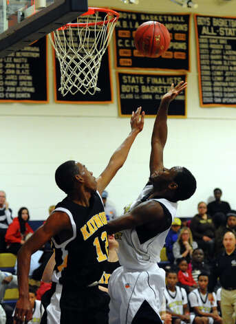 Notre Dame of Fairfield's #5 Earl Coleman attempts a shot but is disrupted by Kaynor Tech's #12 Deandre Gibbs, during boys basketball SWC Tip-off Tournament action in Fairfield, Conn. on Thursday December 13, 2012. Photo: Christian Abraham / Connecticut Post