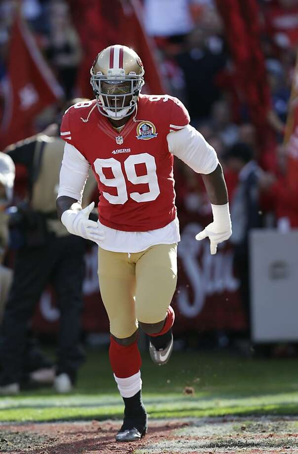 With 19 1/2 sacks this season, the 49ers' Aldon Smith needs 3 1/2 more to break the NFL record held by Michael Strahan. Photo: Marcio Jose Sanchez, Associated Press