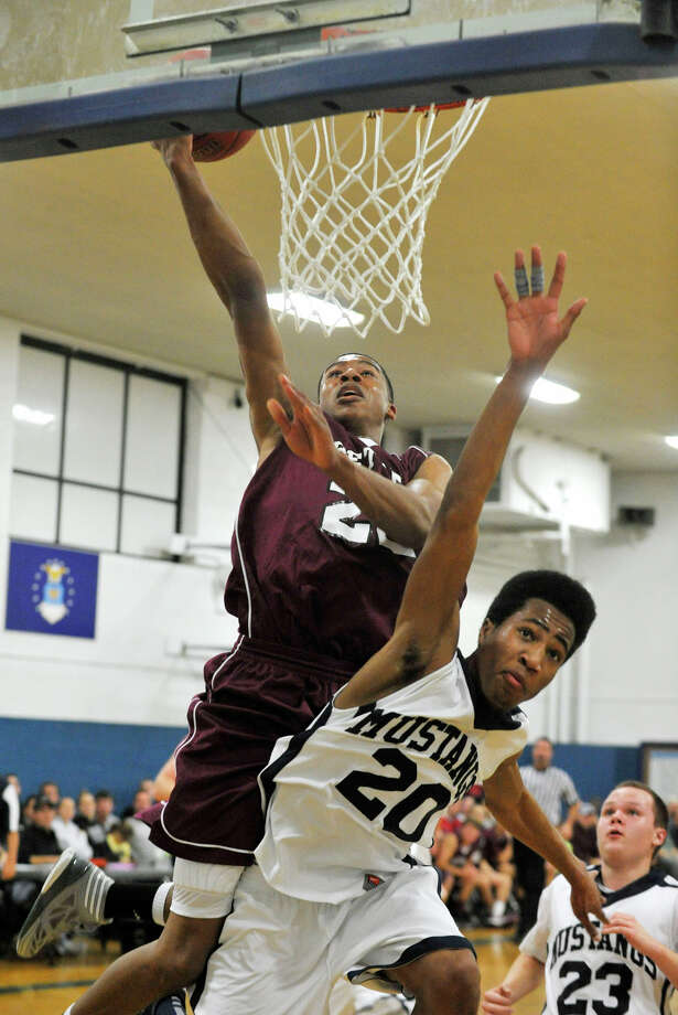 Bethel's Daniel Garvin shoots over Immaculate's Jaden Martin during their game in the first round of The News-Times Greater Danbury Tip-Off Classic at the Danbury War Memorial on Thursday, Dec. 13, 2012. Bethel advanced to the next round beating Immaculate 67-52. Photo: Jason Rearick / The News-Times