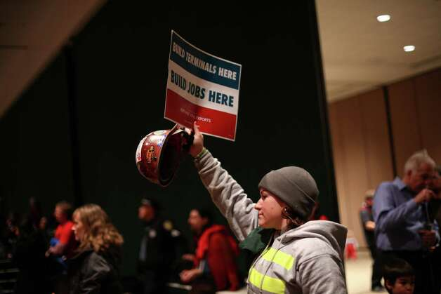 "Union iron worker Raven Mullins hoists a sign during a scoping meeting about the proposed Cherry Point coal export terminal in Whatcom County. ""I support the jobs, not pollution,"" she said. Photo: JOSHUA TRUJILLO / SEATTLEPI.COM"