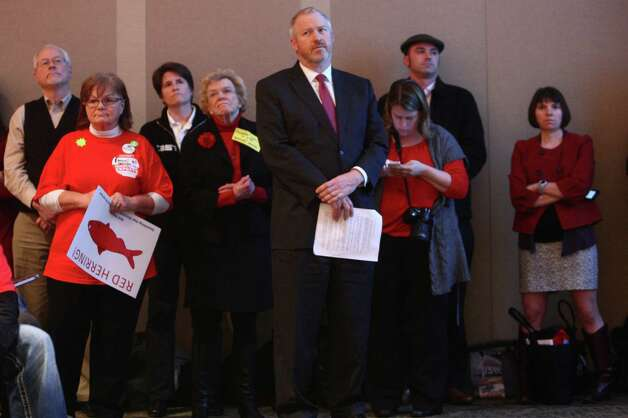 Seattle city leaders, including mayor Mike McGinn, center, wait to speak during a scoping meeting about the proposed Cherry Point coal export terminal in Whatcom County. Photo: JOSHUA TRUJILLO / SEATTLEPI.COM