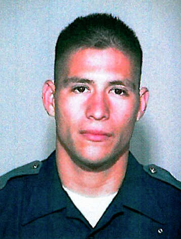 Officer Michael Garza, a 10-year veteran of the department, seen in an undated photo provided by the San Antonio Police Deptartment, was indefinitely suspended effective Nov. 20 following a July 27 incident in which he shot and killed the ex-boyfriend of his lover. / COURTESY OF THE SAPD