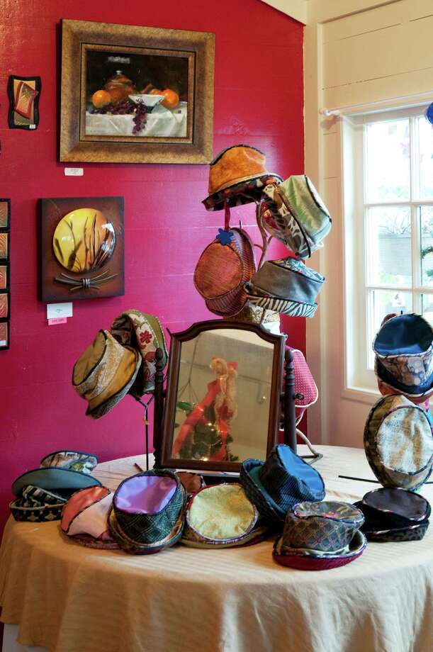 Round TopThis town, about two hours west of Houston, is not just reserved for Antiques Week.Colorful handmade hats fill a table at Comforts, which also specializes in paintings and fine crafts by artists from around the nation.Read: Round Top is the place to be year round Photo: Don Glentzer