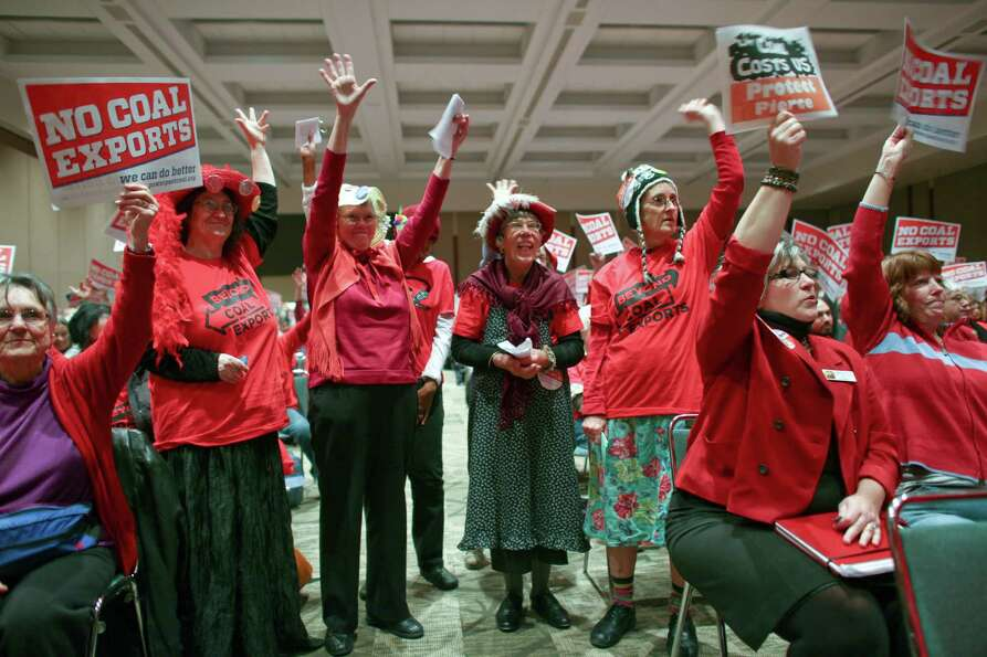 The raging grannies cheer during a scoping meeting about the proposed Cherry Point coal export termi