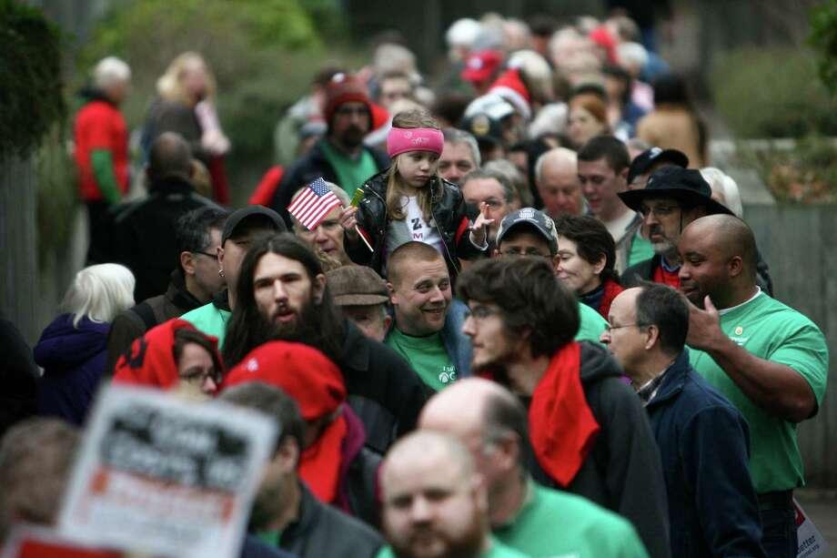 People stream into the Washington State Convention Center. Photo: JOSHUA TRUJILLO / SEATTLEPI.COM