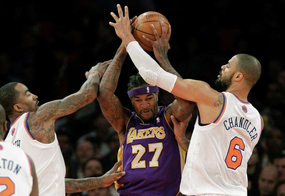 New York Knicks guard J.R. Smith (8) and Knicks center Tyson Chandler (6) defend Los Angeles Lakers center Jordan Hill (27) in the first half of their NBA basketball game at Madison Square Garden in New York, Thursday, Dec. 13, 2012.  (AP Photo/Kathy Willens) Photo: Kathy Willens