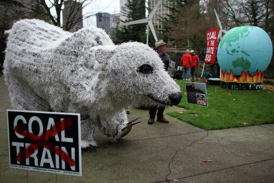 A polar bear puppet created by The Backbone Campaign walks in Freeway Park. Photo: JOSHUA TRUJILLO / SEATTLEPI.COM