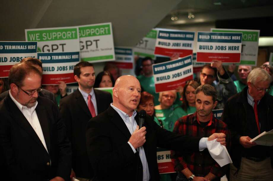 Ferndale Mayor Gary Jensen, center, addresses media and supporters during a scoping meeting about the proposed Cherry Point coal export terminal. Photo: JOSHUA TRUJILLO / SEATTLEPI.COM