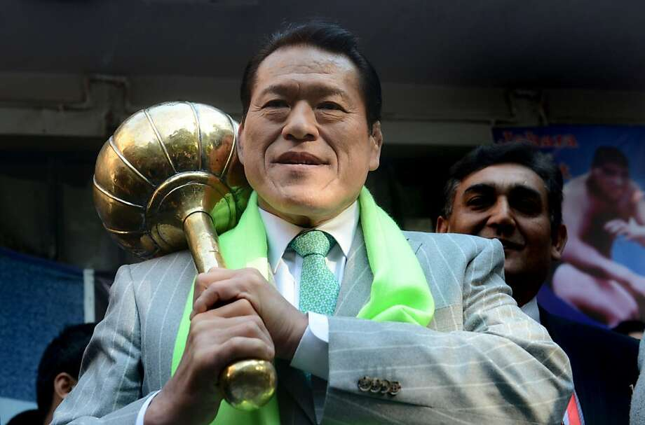 Japanese wrestling star Muhammad Hussain Inoki arrives in Lahore, Pakistan, this month. He is putting on an exhibition and will help establish a government-backed wrestling academy. Photo: Arif Ali, AFP/Getty Images