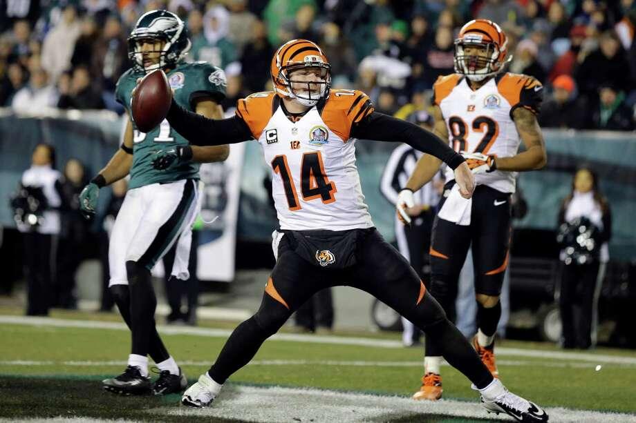 Cincinnati quarterback Andy Dalton (14) celebrates after scoring on an 11-yard run in the third quarter. Photo: Mel Evans, STF / AP