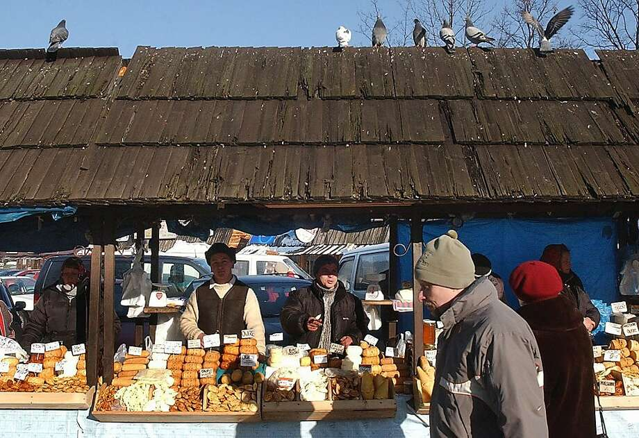 Street vendors sell local oscypek cheese in Zakopane, Poland. Photo: Czarek Sokolowski, Associated Press