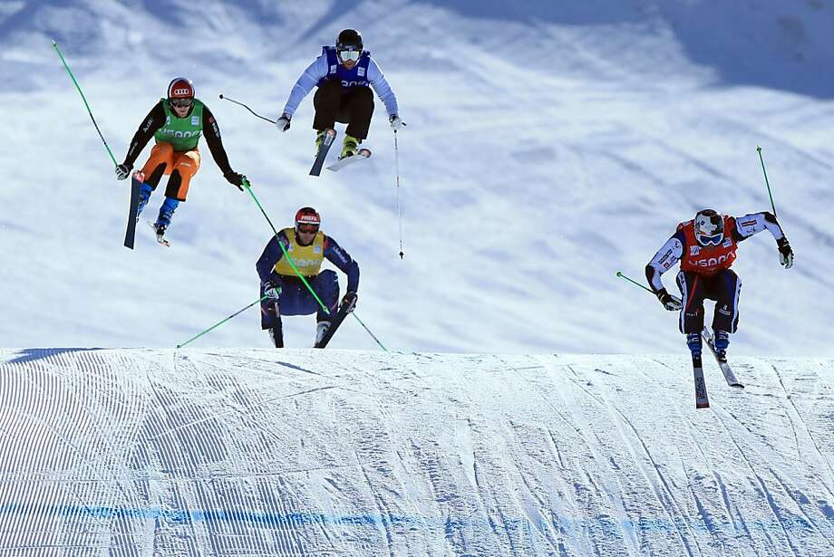 (R-L) Jean Frederic Chapuis of France leads Didrik Bastian Juell of Norway, Andreas Matt of Austria and Simon Stickl of Germany to the finish in their quarter final heat at the Audi FIS Ski Cross World Cup on December 12, 2012 in Telluride, Colorado. Photo: Doug Pensinger, Getty Images