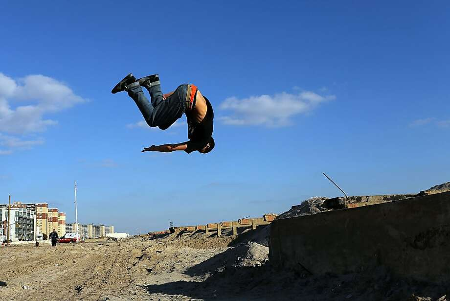 "Alex Marin practices ""parkour"", a sport that embraces the urban landscape as an obstacle course, on the remains of the boardwalk at Rockaway beach on December 13, 2012 in New York City. Much of the Rockaway neighborhood is still suffering the effects of Hurricane Sandy which caused extensive damage to parts of New York, New Jersey and Connecticut. Thousands of Rockaway residents and business owners are still unable to return to their properties while electricity remains sporadic in many neighborhoods. Photo: Spencer Platt, Getty Images"
