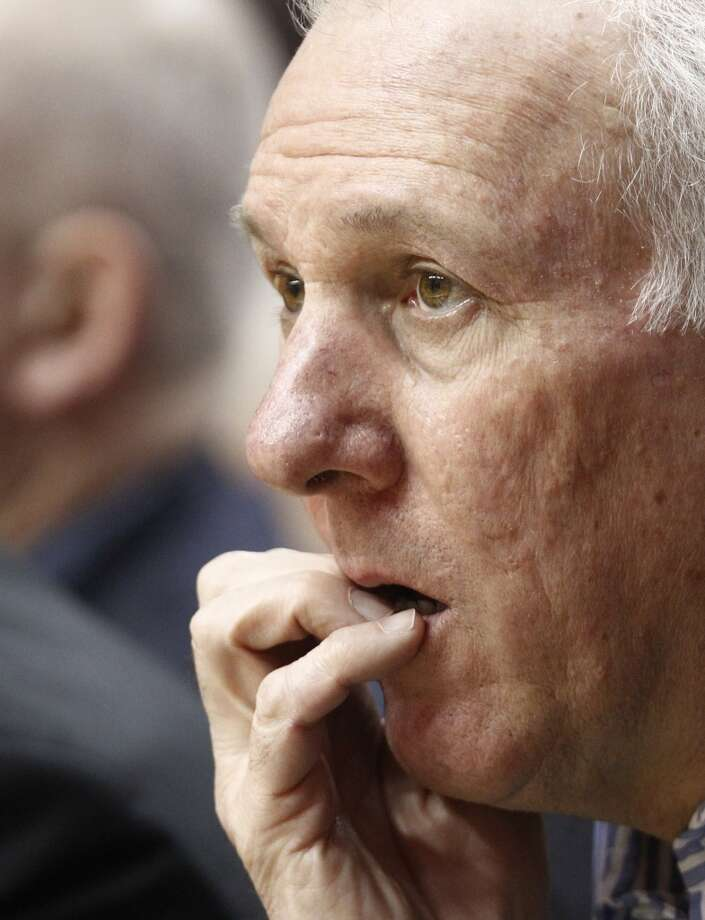 San Antonio Spurs coach Greg Popovich watches from the bench during the first quarter of an NBA basketball game against the Portland Trail Blazers in Portland, Ore., Thursday, Dec. 13, 2012. (AP Photo/Don Ryan) (Associated Press)