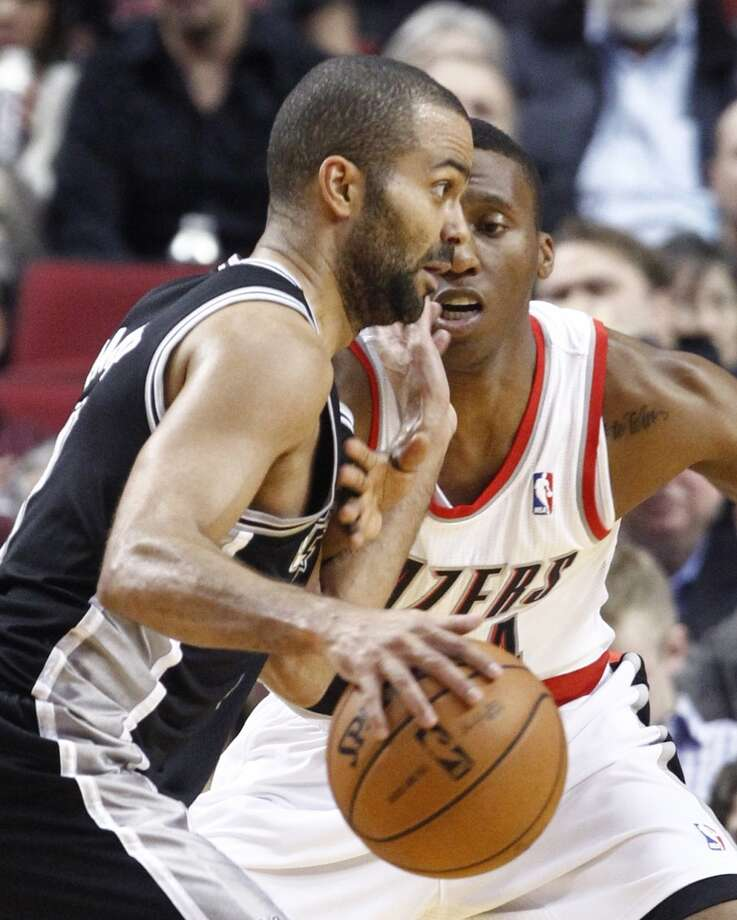 San Antonio Spurs guard Tony Parker, left, drives on Portland Trail Blazers guard Nolan Smith during the first quarter of an NBA basketball game in Portland, Ore., Thursday, Dec. 13, 2012. (AP Photo/Don Ryan) (Associated Press)